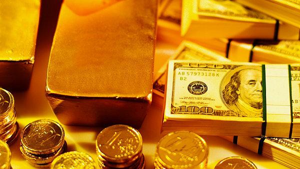 Zlato a dolarov� bankovky, ilustra�n� foto