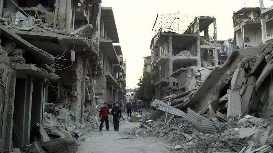 Zničené domy v Homsu