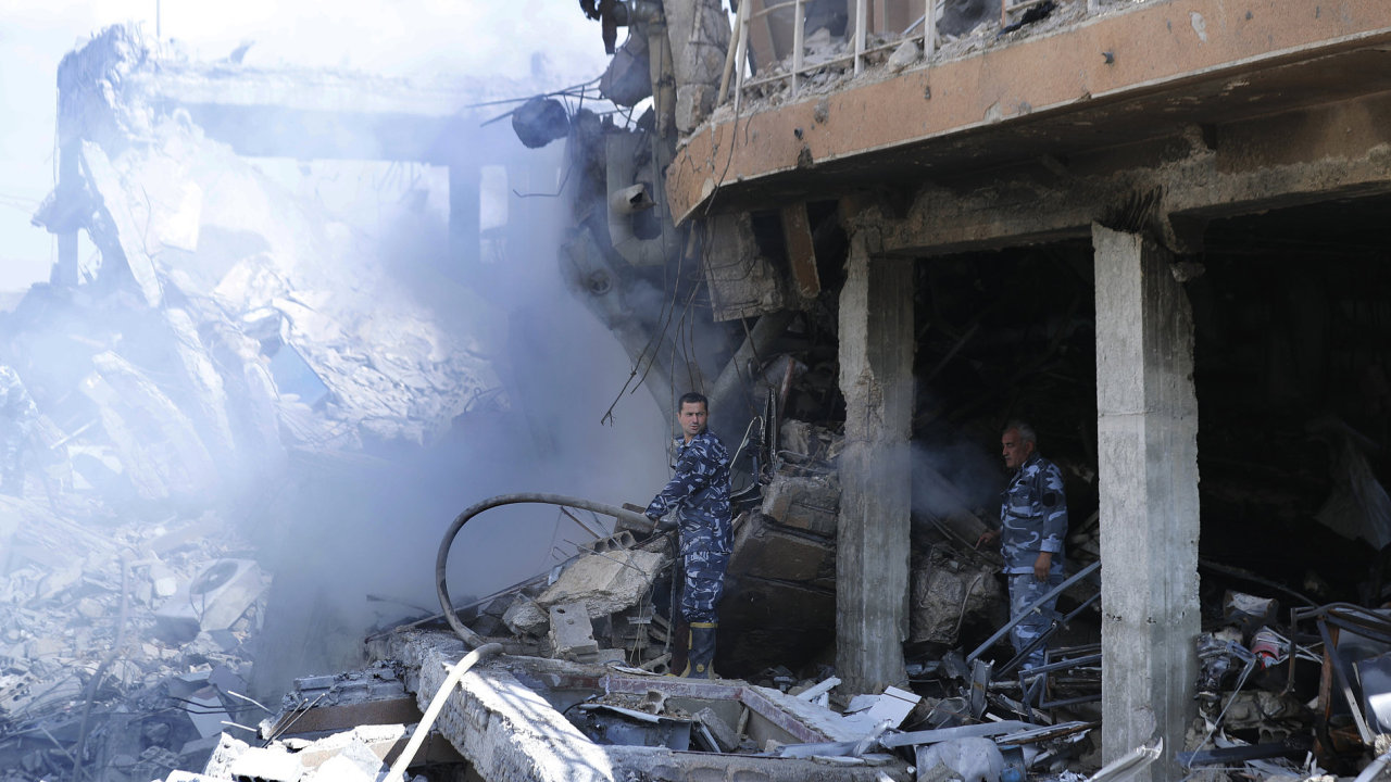 Fireman extinguish smoke that rises from the damage of the Syrian Scientific Research Center which was attacked by U.S.