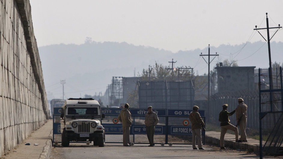 Indian security forces set up a road barrier outside the Indian airbase in Pathankot