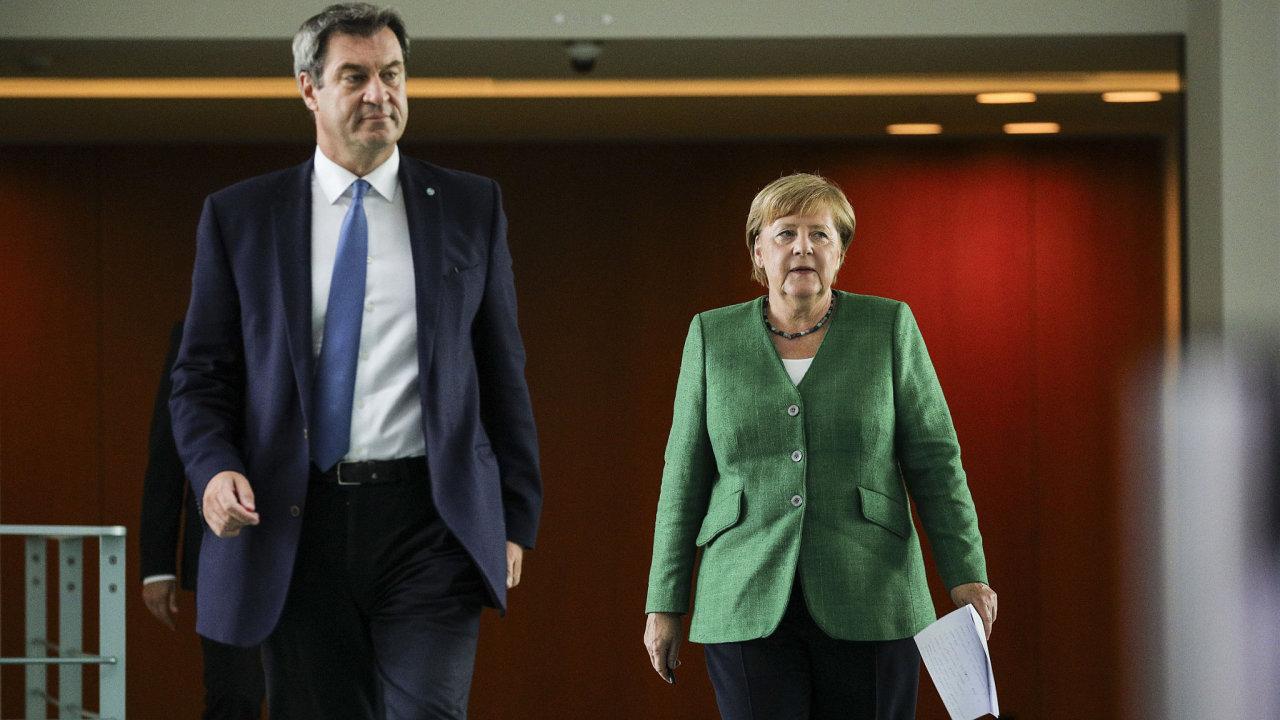 Spolková kancléřka Angela Merkelová (CDU) a bavorský premiér Markus Söder (CSU) museli skousnout porážku křesťanských demokratů v Bádensku-Württembersku aPorýní-Falci. Bodovali naopak Zelení.