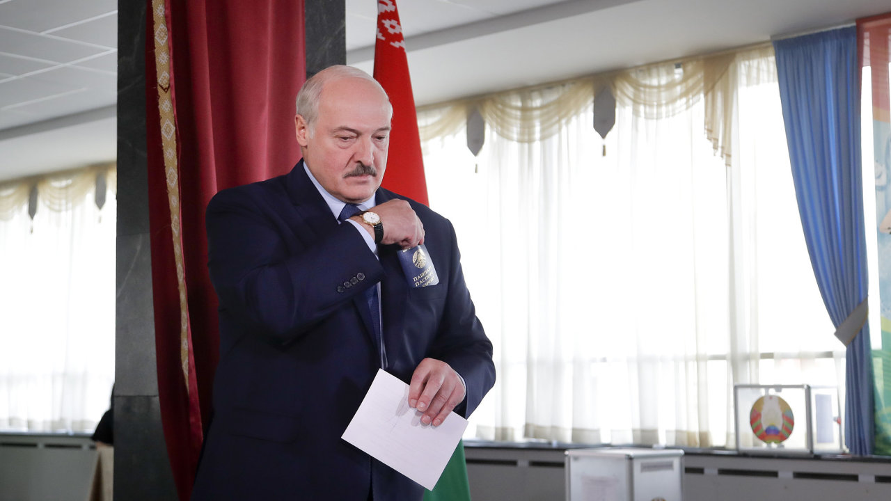 Belarusian President Alexander Lukashenko  walks to cast his ballot at a polling station during the presidential election in Minsk Incumbent Alexander Lukashenko