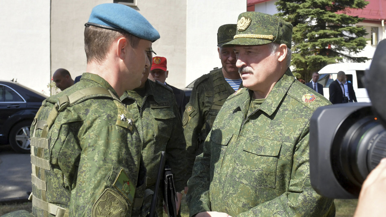 elarusian President Alexander Lukashenko, right, speaks to an officer as he arrives to attend a meeting with military officials in Grodno, Belarus, Saturday, Aug. 22, 2020.