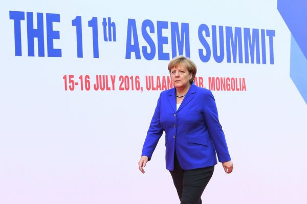German Chancellor Angela Merkel arrives for the 11th Asia-Europe Meeting (ASEM) Summit of Heads of State and Government (ASEM11) in Ulan Bator