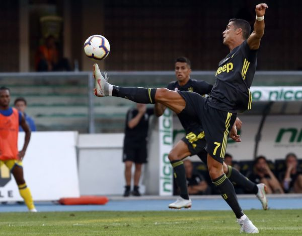 Juventus' Cristiano Ronaldo reaches for the ball during the Serie A soccer match between Chievo Verona and Juventus