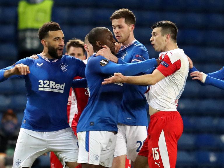 Glen Kamara (2-L) of Rangers argues with Ondrej Kudela (2-R) of Prague during the UEFA Europa League Round of 16