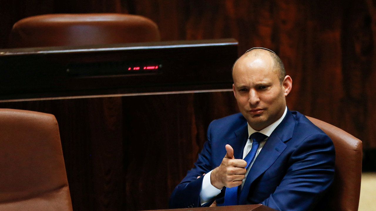 FILE PHOTO: Israeli Education Minister Naftali Bennett gestures during a preliminary vote on a bill at the Knesset