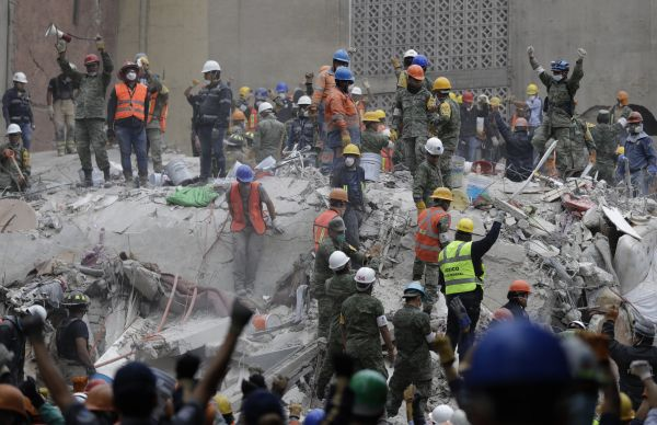 at a building that collapsed after an earthquake in Mexico City