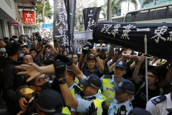 Police break up anti-government protesters and pro-China supporters as they clash in Wang Chai district