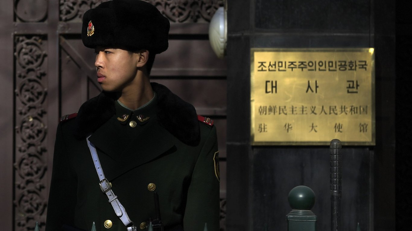 A Chinese paramilitary policeman stands guard outside the North Korean Embassy in Beijing