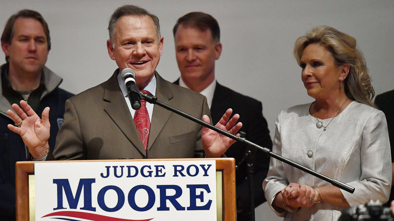 U.S. Senate candidate Roy Moore speaks as his wife U.S. Senate candidate Roy Moore and Kayla Moore look son at the end of an election-night watch party at the RSA activity center