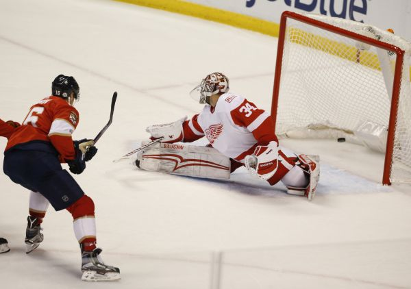 Florida Panthers center Aleksander Barkov (16) scores against Detroit Red Wings goaltender Petr Mrazek (34) during the second period of an NHL hockey game