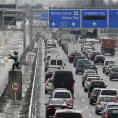 Cars and trucks caught up in a traffic jam at the highway A9 in the morning hours north of Munich February 11