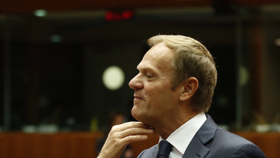 European Council President Donald Tusk gestures as he talks to Lithuanian President Dalia Grybauskaite prior to the start of a round table session during the EU Summit in Brussels