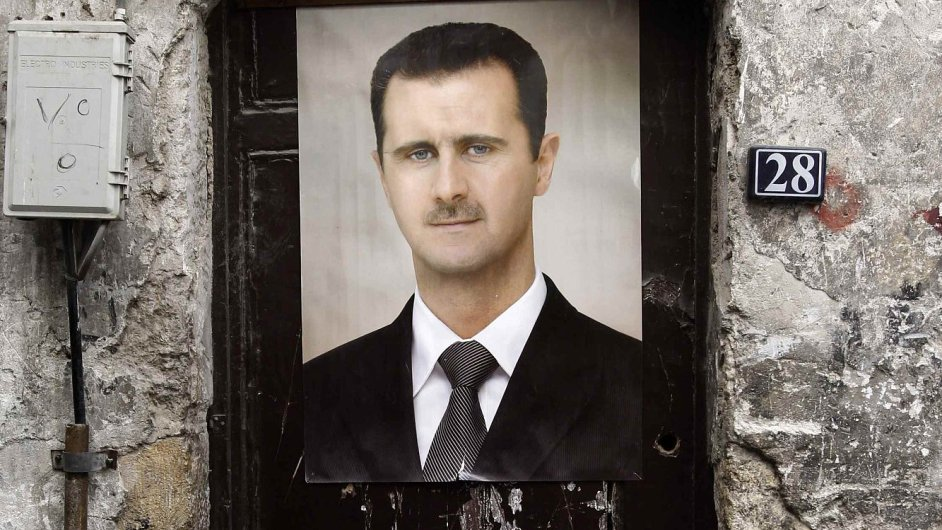 Plakát Bašára Asada v ulicích Damašku