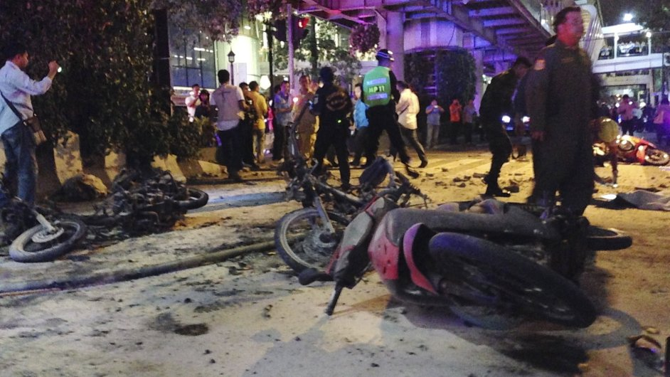 Motorcycles are strewn about after an explosion in Bangkok, Monday, Aug. 17, 2015. A large explosion rocked a central Bangkok intersection during the evening rush hour, killing a number of people and