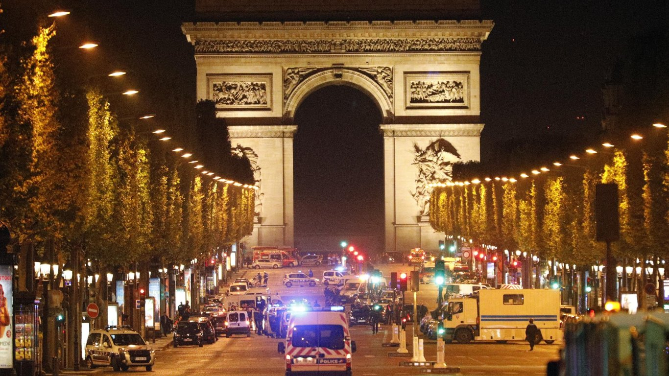 Police forces take positions on the Champs Elysees avenue in Paris