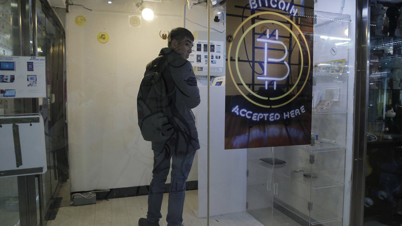 A man uses a Bitcoin ATM in Hong Kong
