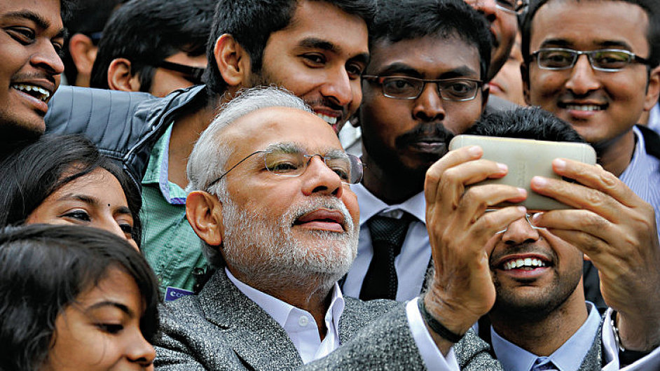 Indian Prime Minister Narendra Modi poses for selfies with Indian students during a visit at the French National Space Agency (CNES) in Toulouse April 11