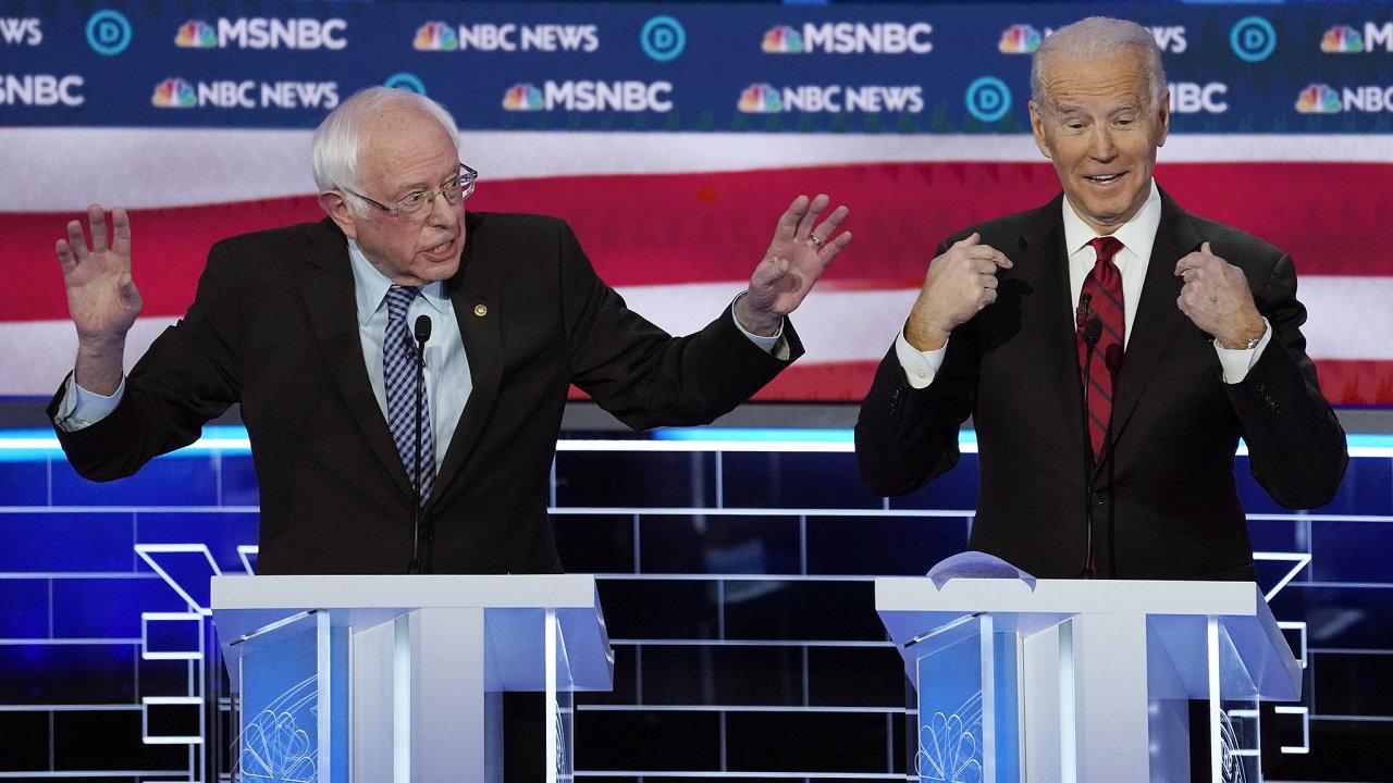 Senator Bernie Sanders speaks as former Vice President Joe Biden gestures towards himself at the ninth Democratic 2020 U.S. Presidential candidates debate at the Paris Theater in Las Vegas