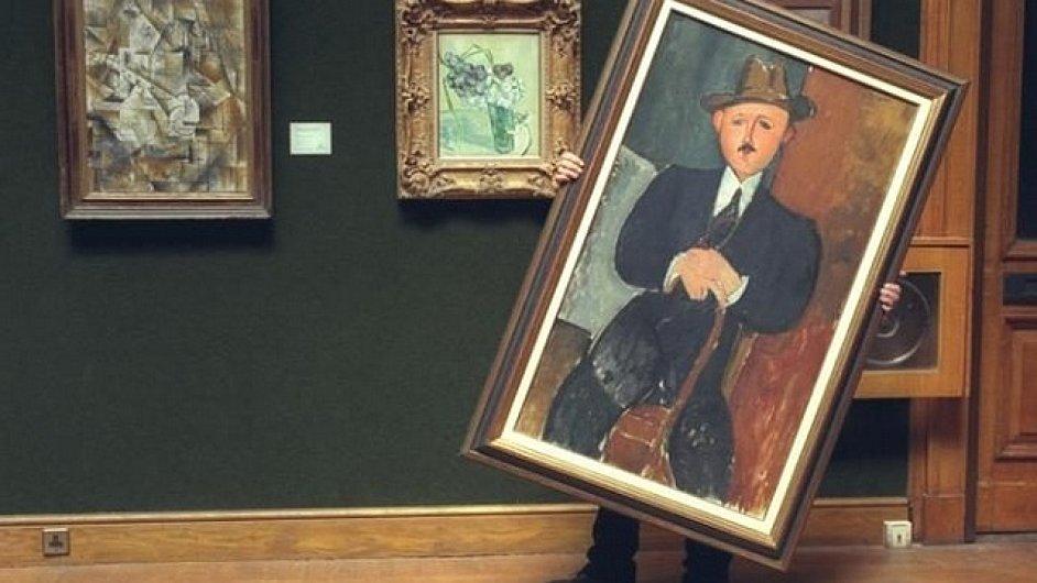 Na snímku Modiglianiho obraz Sedící muž s holí z roku 1918.