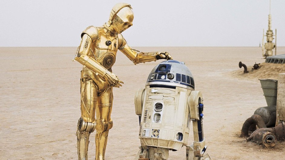 Kenny Baker aneb R2-D2 (vpravo) a Anthony Daniels jako C-3PO v prvním dílu Hvězdných válek.