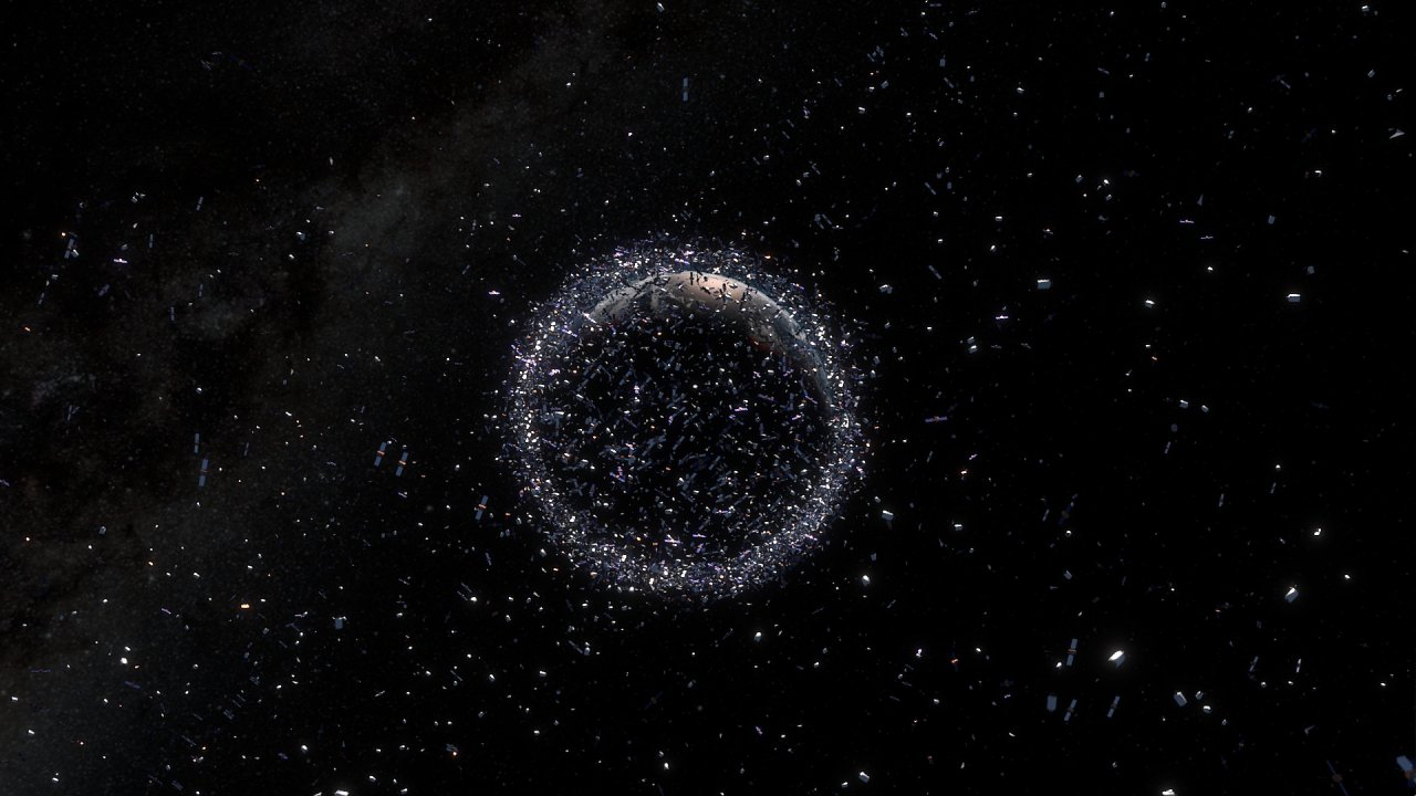Kosmické smetí kolem planety Země - umělecká představa. (Copyright: CC BY-SA 3.0 IGO)