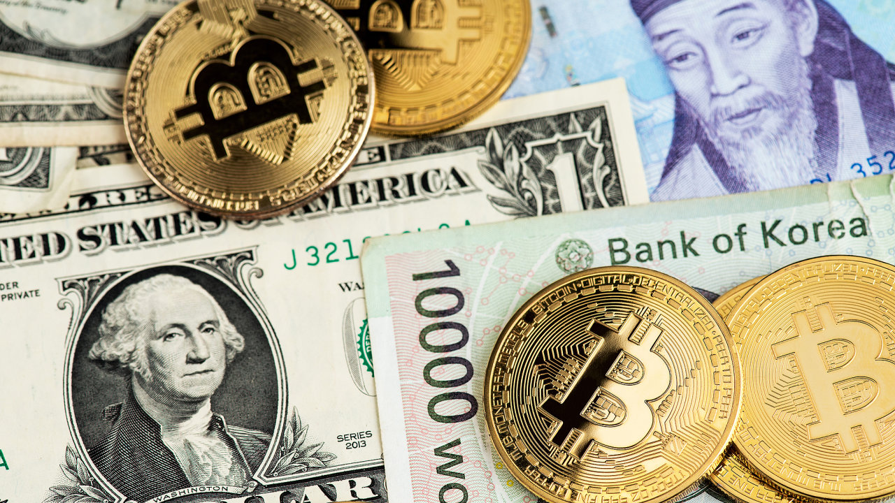 Bitcoin Cryptocurrency coins on South Korea Won and US Dollar currency banknotes close up image. Bitcoin Cryptocurrency concept. Asia BTC Bitcoin Cryptocurrency USA  Dollar USD South Korea Won KRW