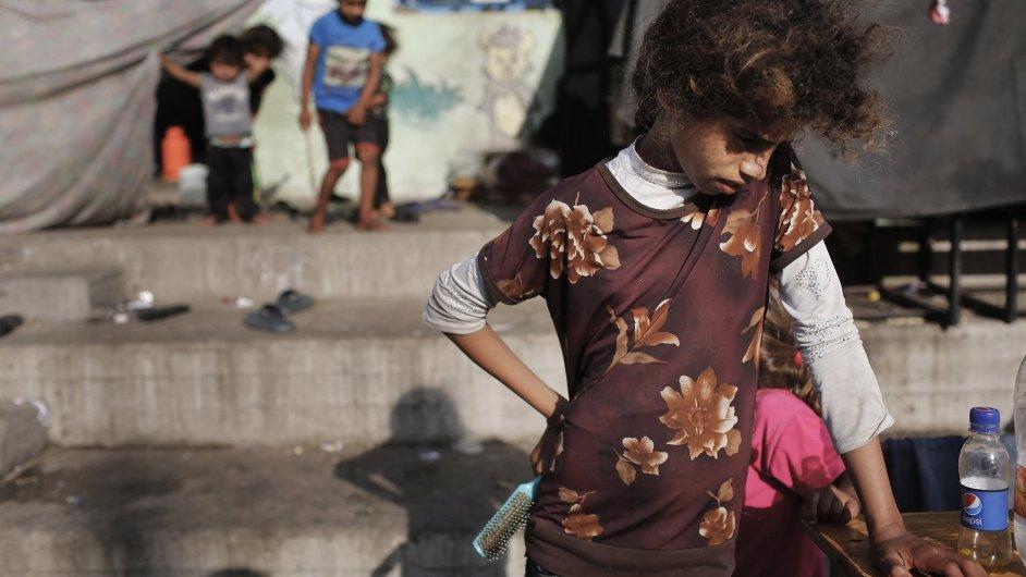 Raketou zasažená škola v Gaze, která sloužila jako uprchlický tábor OSN, zabil a zranil mnoho žen a dětí.