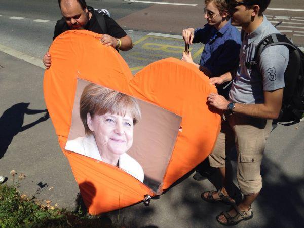 Demonstrace Angela Merkelová příznivci