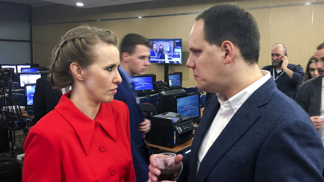 Russian presidential hopeful Ksenia Sobchak speaks to a journalist prior to Russian President Vladimir Putin's annual news conference in Moscow