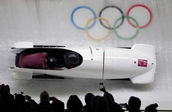 Driver Nadezhda Sergeeva and Anastasia Kocherzhova of the Olympic Athletes of Russia take a curve in their third heat during the women's two-man bobsled final at the 2018 Winter Olympics in Pyeongchan