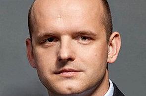 Analytik J&T Bank Praha Milan Lávička.