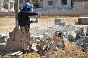 Inspektor OSN při vyšetřování chemického útoku v Damašku