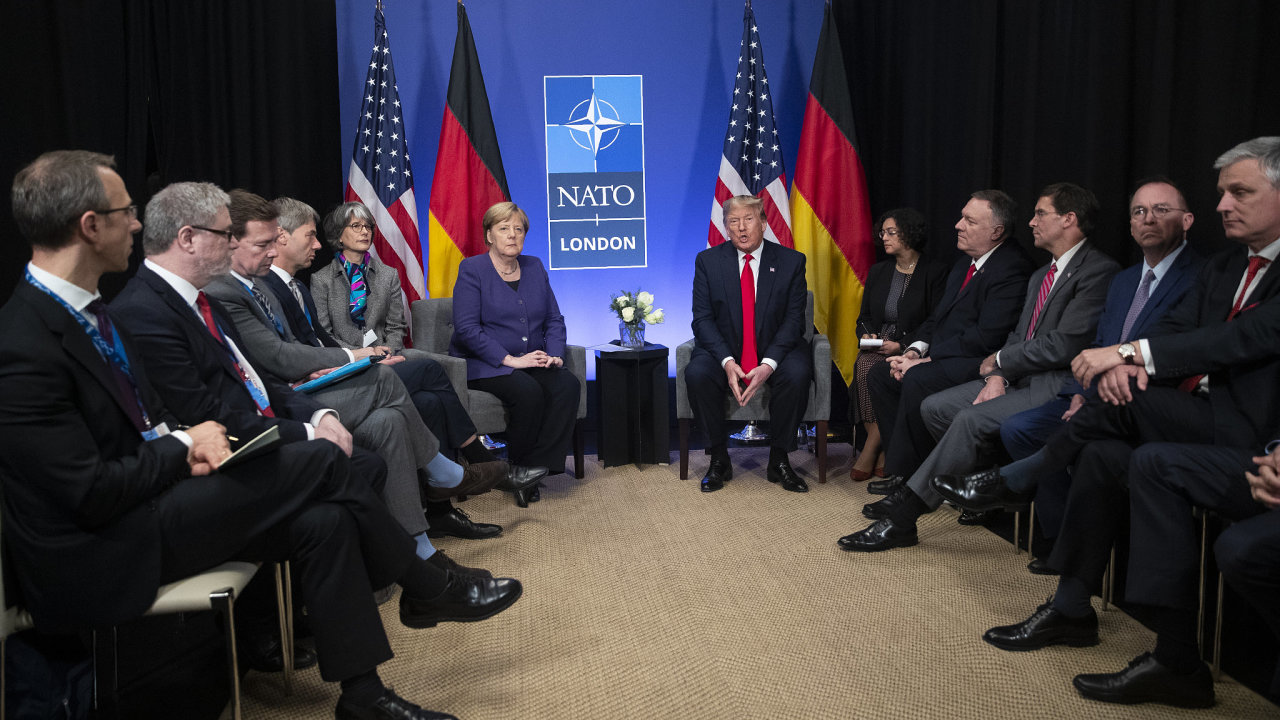 President Donald Trump meets with German Chancellor Angela Merkel during the NATO summit at The Grove