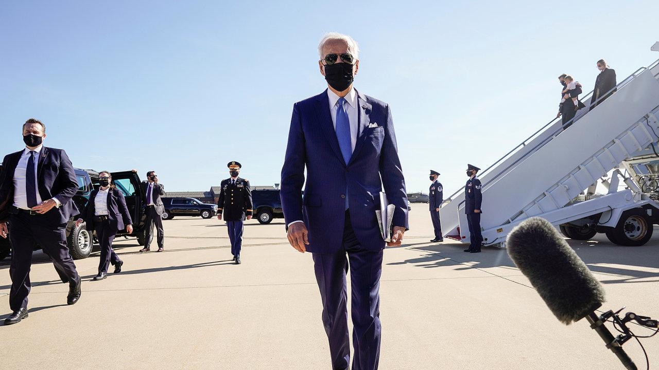 U.S. President Joe Biden walks to speak to the media as he arrives in Newcastle