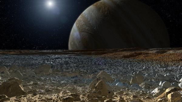 Mimozemský život je možná uvězněný pod vrstvou ledu. Simulovaný obrázek pohledu na Jupiter z jeho měsíce Europa.