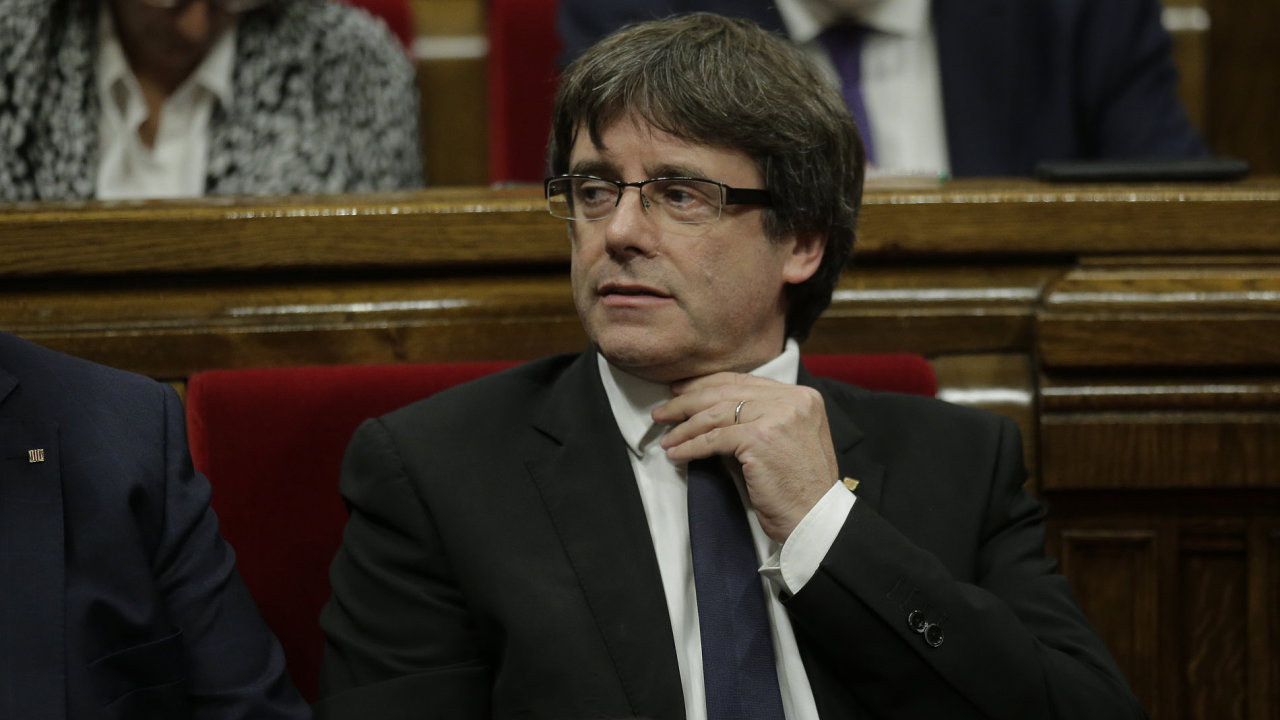 Catalan regional President Carles Puigdemont waits to make his opening speech at the parliament in Barcelona