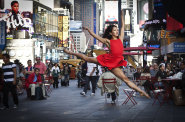 """A dancer poses for a photograph as part of the """"Dance as Art"""" photo project in Times Square in New York September 22"""