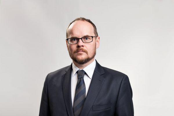 Leoš Rousek - hlavní analytik.