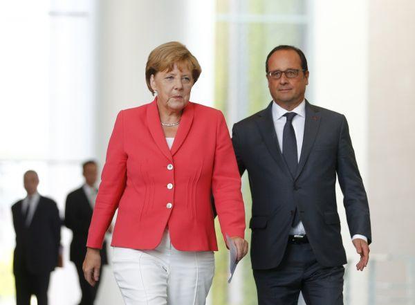 Kanclé�ka Merkelová s prezidentem Hollandem.