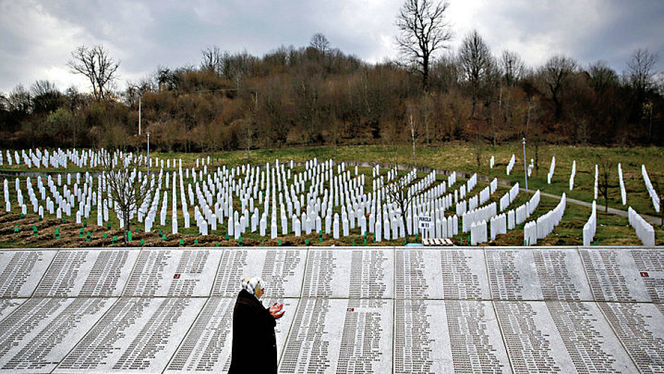 Fadila Efendic prays near memorial plaques at the Potocari genocide memorial centre near Srebrenica REUTERS/Dado Ruvic (BOSNIA AND HERZEGOVINA - Tags: SOCIETY CIVIL UNREST TPX IMAGES OF THE DAY) - RT