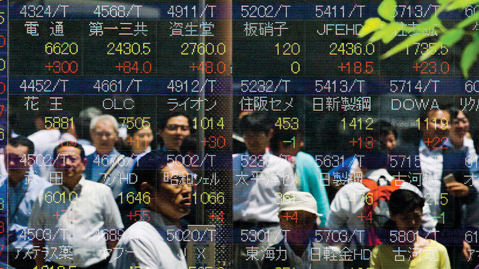 People are reflected in a board displaying stock indices in Tokyo July 10 - RTX1JT5O