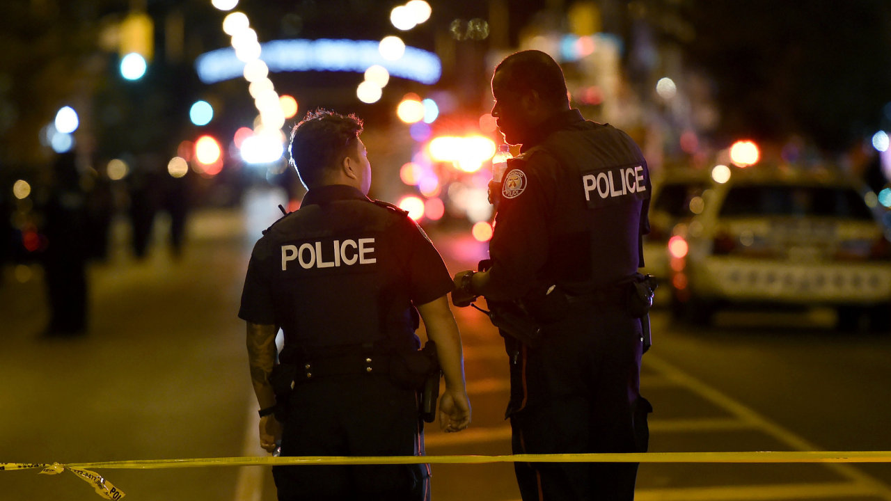 Police work at the scene of a mass casualty incident in Toronto on Sunday