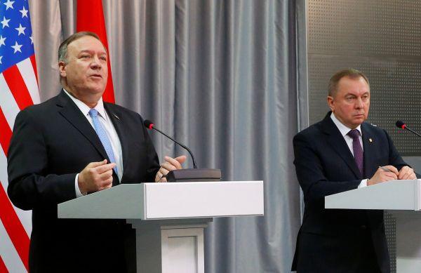 Mike Pompeo a Alexandr Lukašenko.