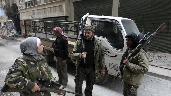 Bojovníci proti režimu Bašára Asada v roce 2013