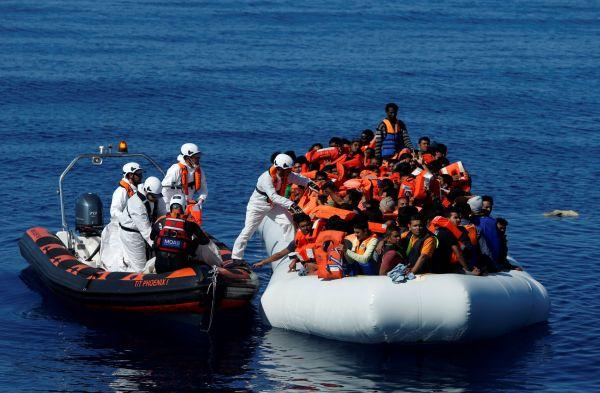 Migranti,uprchlíci