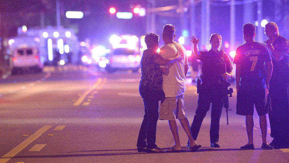 Orlando Police officers direct family members away from a multiple shooting at a nightclub in Orlando