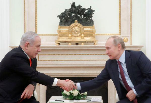 Benjamin Netanjahu a Vladimir Putin.