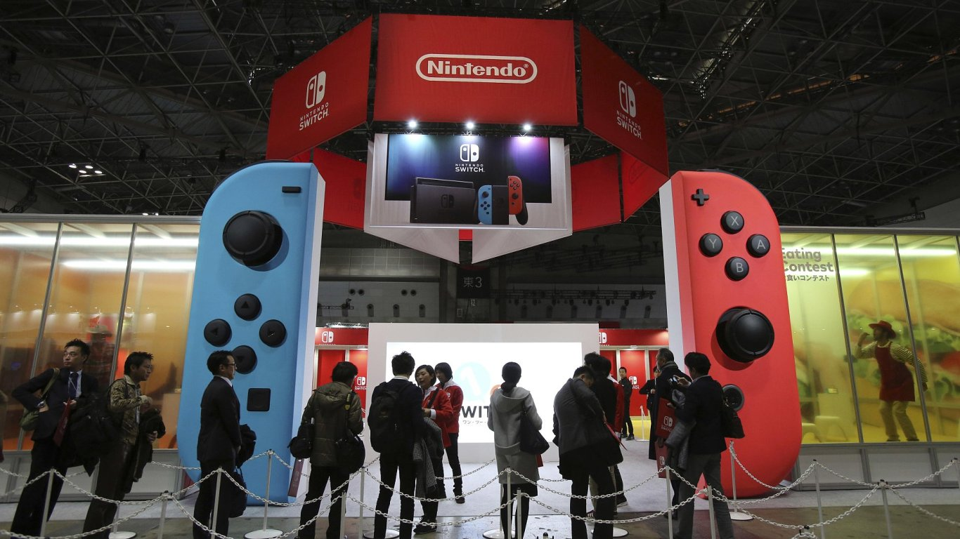 Media wait outside the venue for the presentation of the new Nintendo Switch in Tokyo